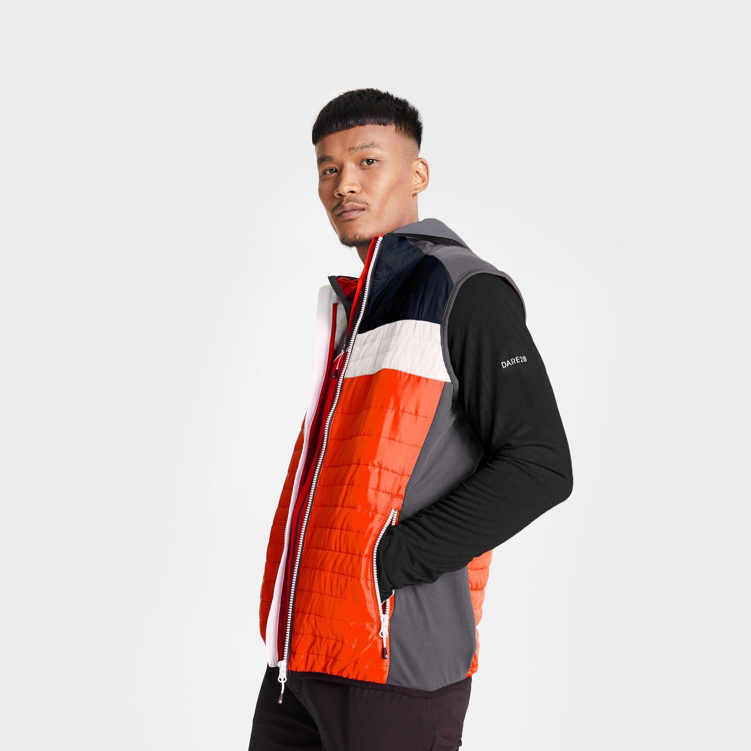 Model wearing a orange, grey and black hybrid jacket