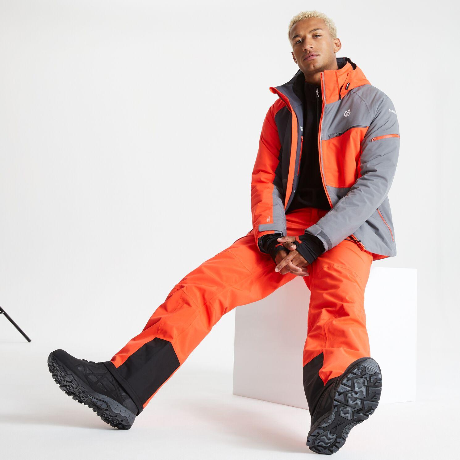 model wearing orange ski outfit